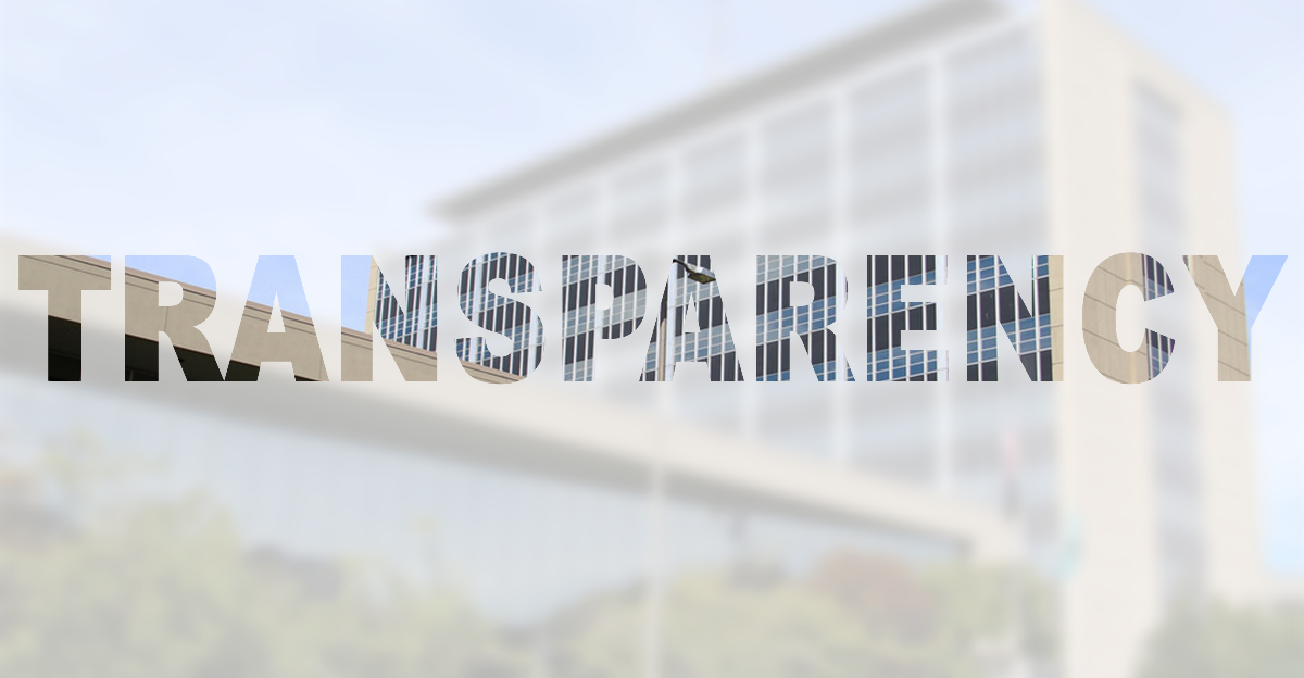transparency text in front of opaque picture of the Pierce County City Building