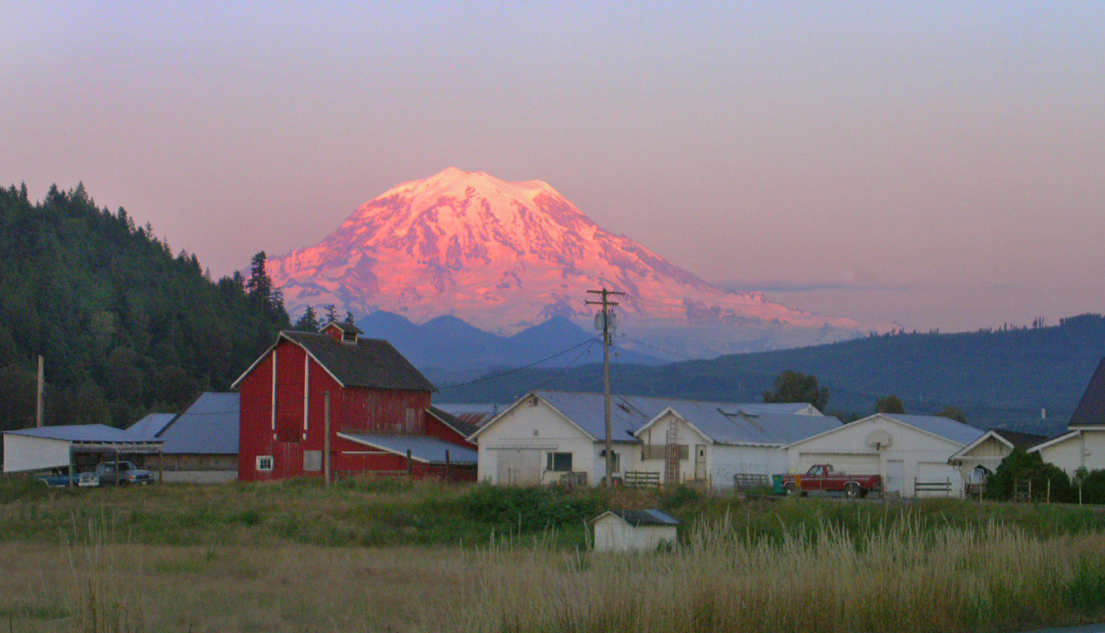 Sun setting on Mt Rainier from an Orting farm.